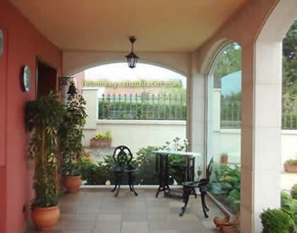 Reformar casas y porches construcciones mansuri for Imagenes de porches de casas