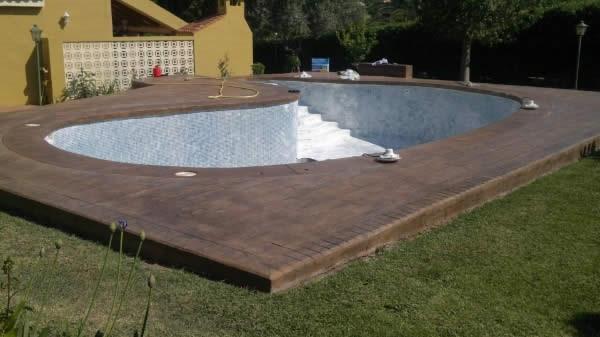Construccion de piscinas en valencia hormig n impreso for Empresas construccion piscinas