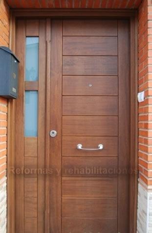Puertas calle madera materiales de construcci n para la for Puertas de calle aluminio precios
